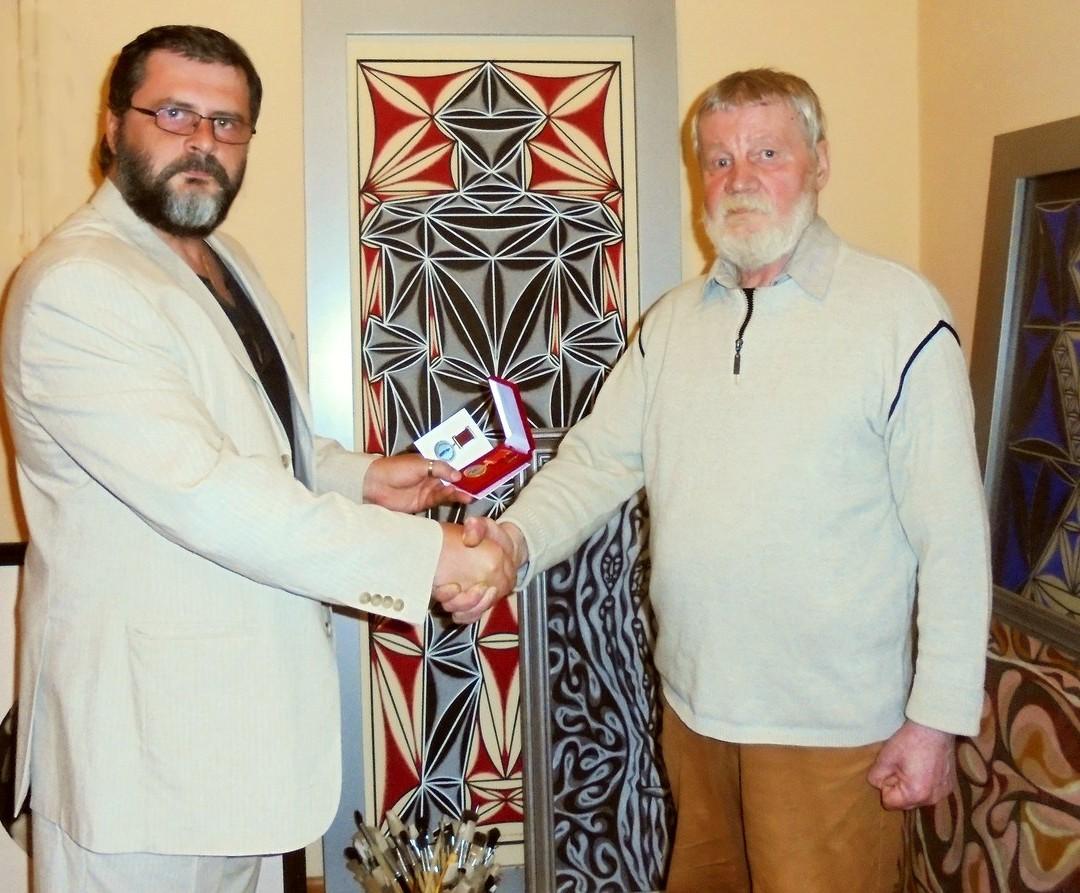 Выдающийся фотохудожник и художник Михаил Ладейщиков награжден Почетной медалью Профессионального союза художников России.